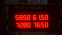 Russians unfazed as rouble hits historic lows