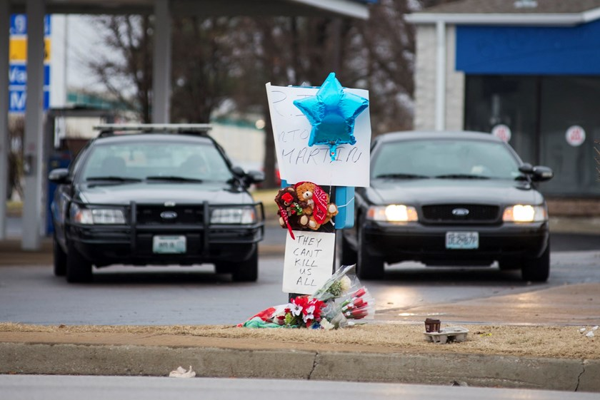 A memorial for Antonio Martin, an armed 18-year old black teen who was fatally shot by police in Berkeley, Missouri, December 24, 2014. A white policeman shot dead a black man brandishing a gun at a suburban St. Louis gasoline station overnight, police sa