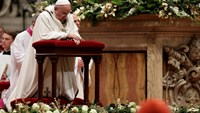 Pope Francis kneels as he leads the Christmas night mass in Saint Peter's Basilica at the Vatican December 24, 2014. Photo: Reuters/Max Rossi