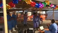 Red Cross workers dance up Christmas cheer
