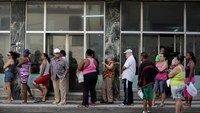 People line up outside a state pharmacy to buy medicine in Havana December 27, 2014. Photo credit: Reuters