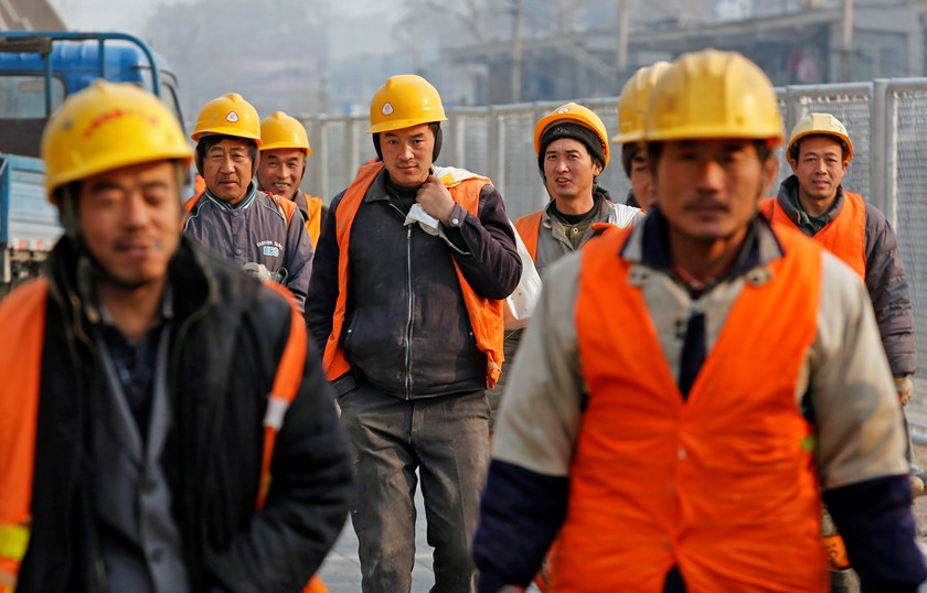 Workers head to a construction site in Beijing December 26, 2014. Photo credit: Reuters