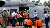 AirAsia searchers recover body from choppy seas