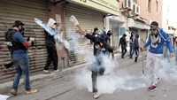 Protesters, police clash after Washington criticizes Bahrain arrest