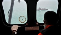 A Malaysian Navy ship is seen from an Indonesian Air Force Super Puma helicopter during a search mission for for AirAsia flight QZ8501 off the coast of Central Kalimantan January 6, 2015. Photo: Reuters