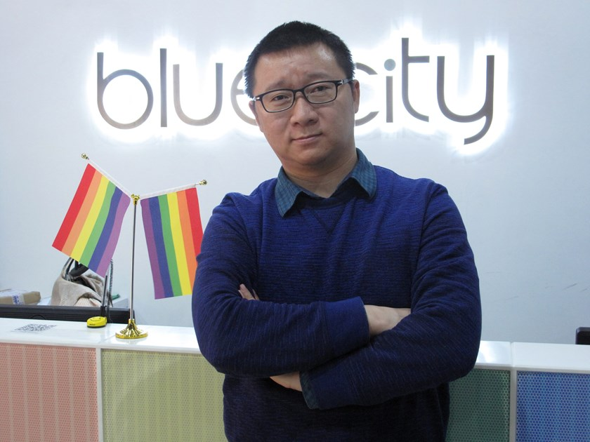 Ma Baoli, founder of Blue City, parent company of Chinese gay dating app Blued, poses for pictures at his office reception area in Beijing, January 7, 2015. The free Chinese-language app uses the GPS capability of users' smartphones to identify nearby mem