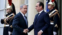 Netanyahu greeted with cheers at Paris Grand Synagogue