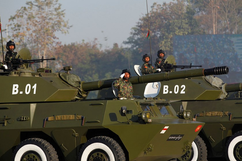 A soldier salutes as he rides a military vehicle during the Grand Military Review Parade ceremony to mark the 67th Myanmar Independence Day in Naypyitaw January 4, 2015. Photo: Reuters/Soe Zeya Tun
