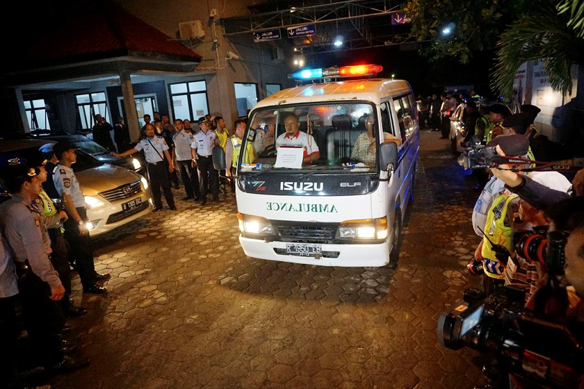 An ambulance transports the body of Nigerian prisoner Daniel Enemuo from Nusa Kambangan prison, where five of six prisoners were executed, at Wijayapura quay, Cilacap, Central Java, January 18, 2015, in this photo taken by Antara Foto