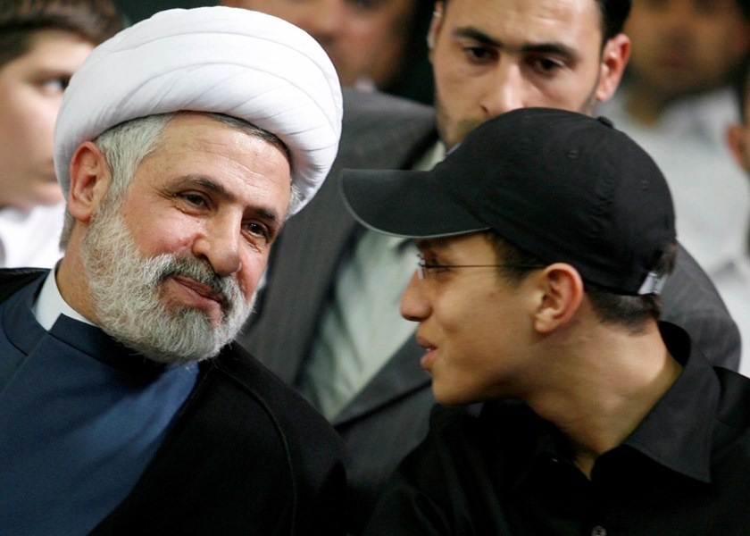 Jihad Moughniyah (R), son of Lebanon's Hezbollah late military leader Imad Moughniyah, sits beside Hizbollah Deputy Secretary General Naeem Kassem during a ceremony marking his fathers 40th death in Beirut's suburbs in this March 24, 2008 file photo. REUT