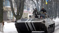 Members of the Ukrainian armed forces drive an armored vehicle in the town of Volnovakha, eastern Ukraine, January 18, 2015. Photo: Reuters/Alexander Ermochenko