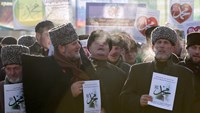 People attend a rally to protest against satirical cartoons of prophet Mohammad, in Grozny, Chechnya January 19, 2015. Tens of thousands of people staged the rally on Monday in Chechnya against French magazine Charlie Hebdo's cartoons of the prophet, whic