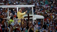 Pope Francis waves from the popemobile after leading a Mass at Rizal Park in Manila January 18, 2015. Huge crowds converged on a Manila park on Sunday to see Pope Francis wrap up his Asian trip with an outdoor Mass expected to draw one of the largest crow