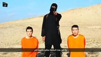 IS video purports to show Japanese citizens being held hostage