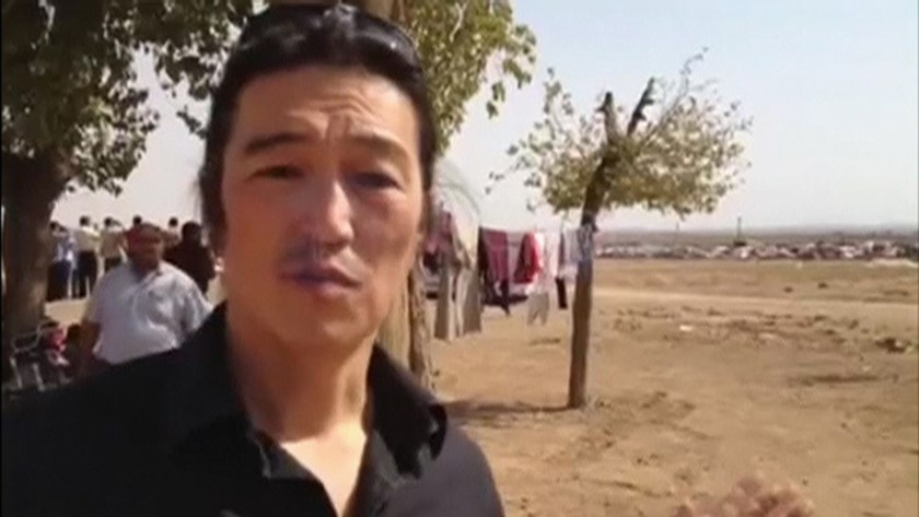 A man purported to be Japanese journalist Kenji Goto is seen in this still image from a video provided by the website www.reportr.co, that said he is reporting in Kobani in October 2014.  Mandatory Credit. REUTERS/www.reportr.co via Reuters TV