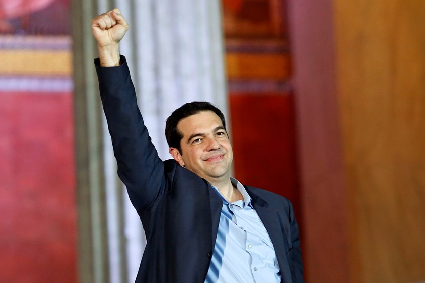 The head of radical leftist Syriza party Alexis Tsipras raises his fist to supporters after winning the elections in Athens January 25, 2015. Greek leftist leader Tsipras hailed the projected victory of his anti-austerity Syriza party in Sunday's snap ele