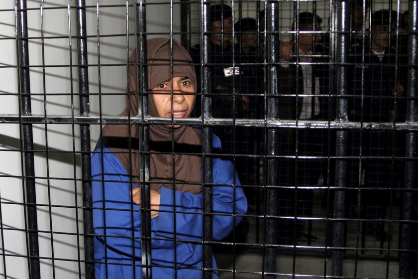 Iraqi would-be suicide bomber Sajida al-Rishawi stands inside a military court at Juwaida prison in Amman in this April 24, 2006 file photo. REUTERS/Majed Jaber/Files