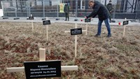 Kiev protesters plant crosses at Russian embassy for civilians killed in shellfire