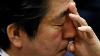 Japan's Prime Minister Shinzo Abe scratches his face during an upper house committee session at the parliament in Tokyo February 2, 2015. The only way to fight terrorism is by working with the international community and boosting mechanisms to ensure the