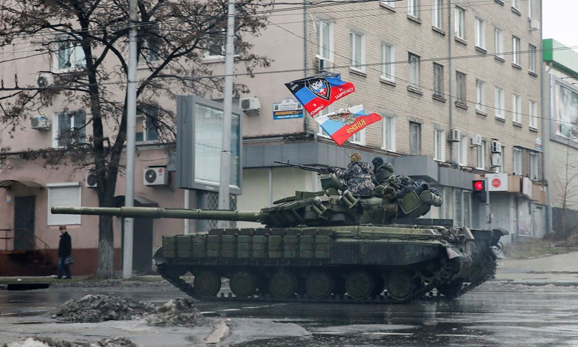 Pro-Russian separatists ride on a tank in Donetsk, eastern Ukraine, February 1, 2015. REUTERS/Maxim Shemetov