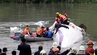 At least nine dead after Taiwan plane crashes into river