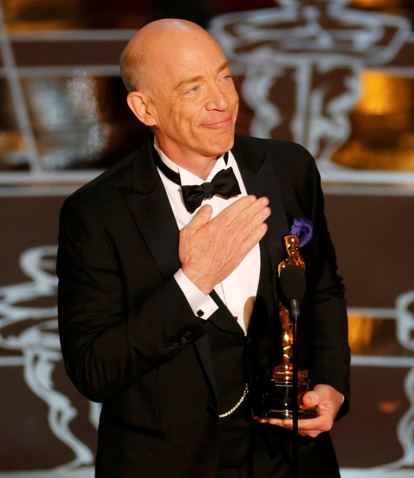 "J.K. Simmons receives the Oscar for actor in a supporting role for ""Whiplash"" at the 87th Academy Awards in Hollywood, California February 22, 2015. Photo credit: Reuters"