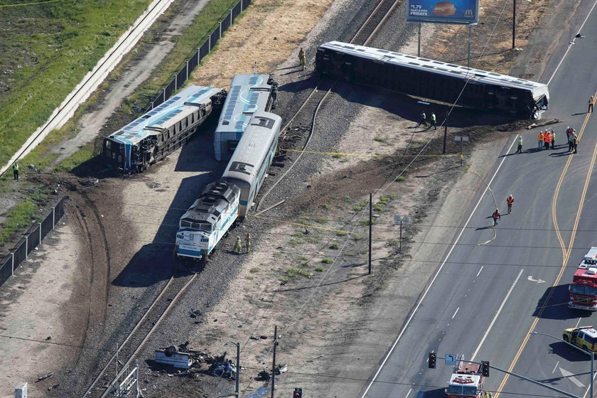 An aerial view shows the scene of a double-decker Metrolink train derailment in Oxnard, California February 24, 2015. REUTERS/Lucy Nicholson