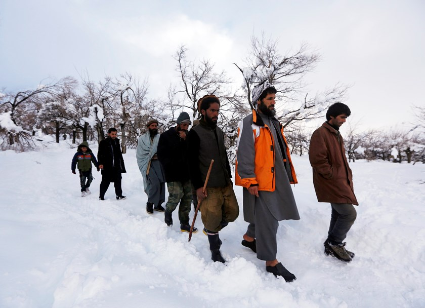Relatives of avalanche victims return after conducting a search for the victims in Panjshir province, February 25, 2015. More than 90 people have been killed in Afghanistan in some of the worst avalanches there for 30 years, officials said on Wednesday, w