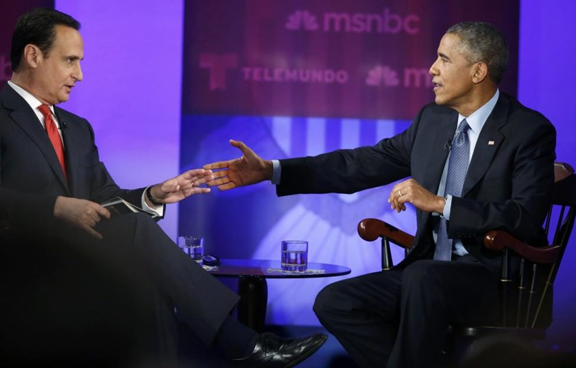 U.S. President Barack Obama (R) participates in the taping of an MSNBC/Telemundo town hall discussion on immigration with host Jose Diaz-Balart (L) at Florida International University in Miami, February 25, 2015. REUTERS/Jonathan Ernst