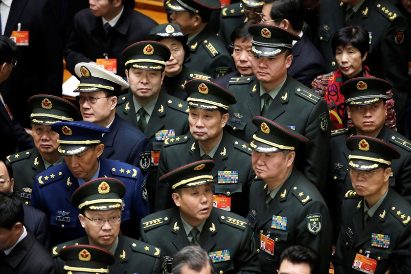 Military delegates wait to leave after the opening of the annual full session of the National People's Congress, the country's parliament, at Great Hall of the People, in Beijing, March 5, 2015.