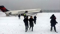 Delta plane slides off runway at New York's LaGuardia Airport