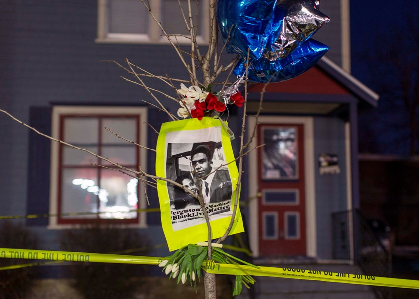 A makeshift memorial pays tribute to a 19-year-old black man killed by police, in front of a home cordoned off with barricade tape on Williamson Street in Madison, Wisconsin March 7, 2015. Demonstrators marched on Saturday to protest the police killing of