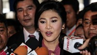Yingluck Shinawatra, Thailand's former prime minister, speaks to members of the media as she arrives at Parliament House in Bangkok, Thailand. File photo