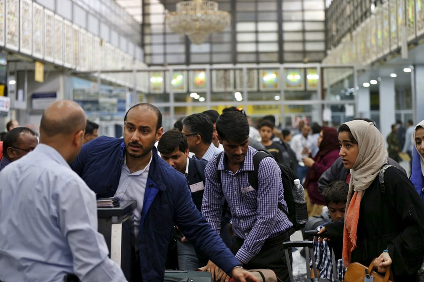 People wait to check in for their flights at Sanaa Airport March 28, 2015. Photo: Reuters
