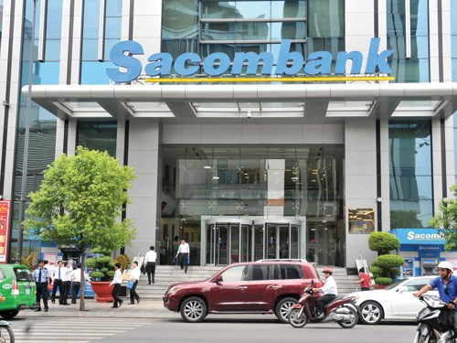 Vehicles pass by a Sacombank office. File photo