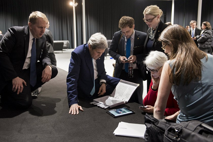 U.S. Secretary of State John Kerry (2nd L), U.S. Under Secretary for Political Affairs Wendy Sherman (2nd R) and staff watch a tablet in Lausanne as U.S. President Barack Obama makes a state address on the status of the Iran nuclear program talks, April 2