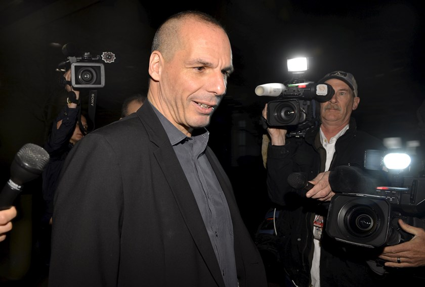 "Greek Finance Minister Yanis Varoufakis is surrounded by members of the media as he comments on the ""informal discussions"" he had just concluded with the International Monetary Fund Managing Director Christine Lagarde, in Washington, April 5, 2015. Photo:"