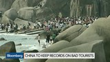 China tells unruly travelers to 'behave'