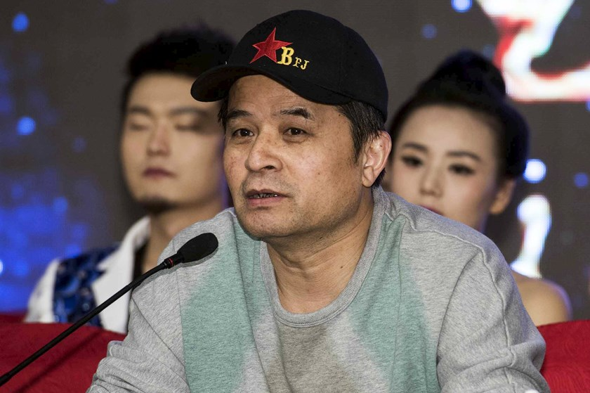 Bi Fujian, an anchor of China Central Television (CCTV), speaks during a news conference in Beijing, November 21, 2013. China's main state broadcaster, CCTV, will investigate one of its anchors after a video of him insulting the founder of modern China, M
