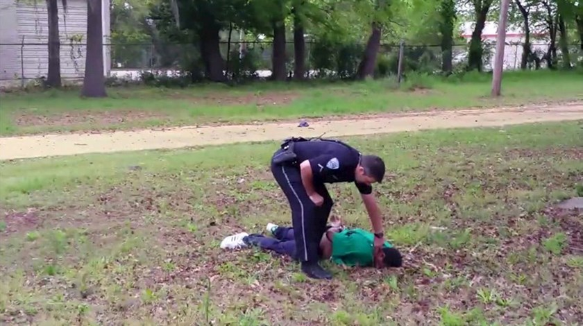 North Charleston police officer Michael Slager is seen standing over 50-year-old Walter Scott after allegedly shooting him in the back as he ran away, in this still image from video in North Charleston, South Carolina taken April 4, 2015. Photo: Reuters