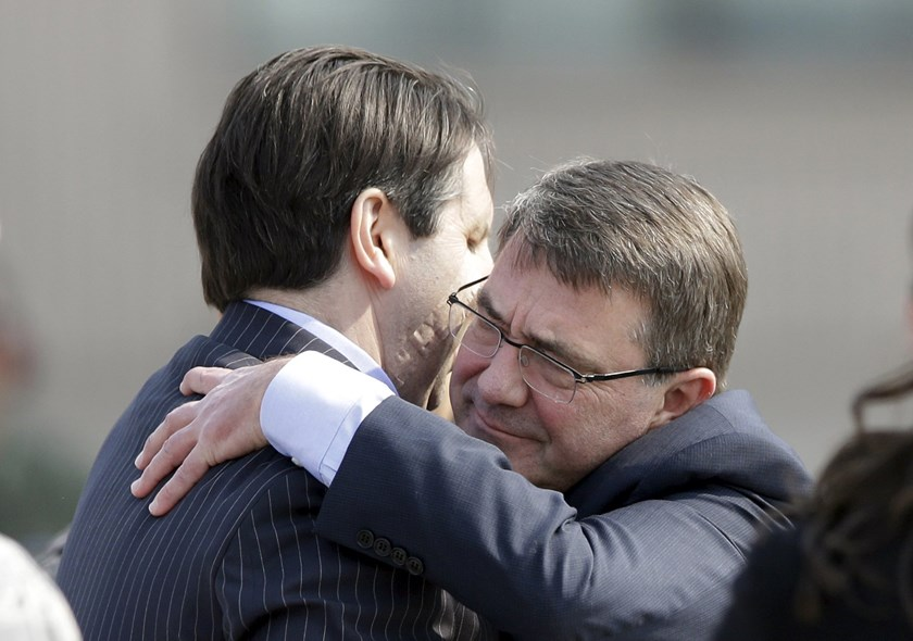 U.S. Defense Secretary Ash Carter (R) hugs with U.S. Ambassador to South Korea Mark Lippert, who was attacked by a man with a knife on March 5, upon his arrival at Osan U.S. Air Base in Pyeongtaek, south of Seoul, South Korea, Thursday, April 9, 2015. REU