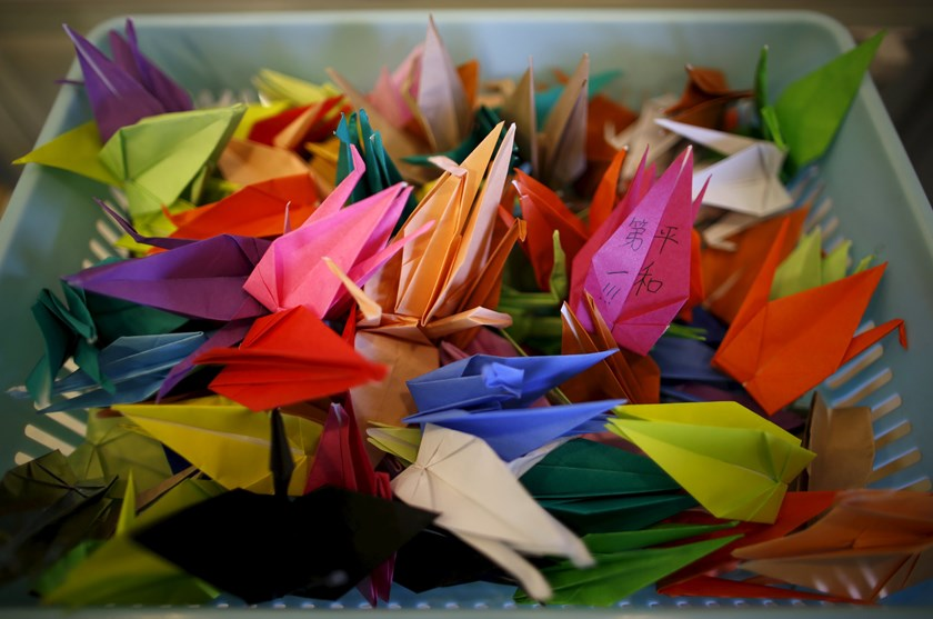 "Paper cranes, with one bearing a written message ""Peace First!!!"", are collected at an exhibition about the 1945 atomic bombings in Higashihiroshima, western Japan, March 26, 2015. Photo: Reuters"