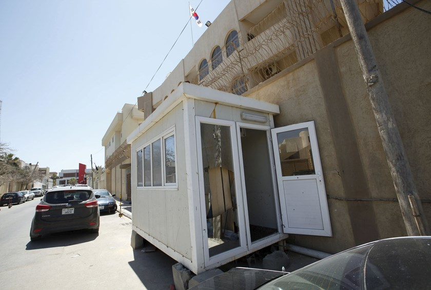 A damaged cabin is seen outside the South Korean embassy after it was attacked by gunmen in Tripoli April 12, 2015. Photo: Reuters