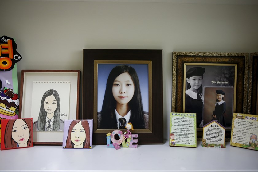 Pictures are seen in a room belonging to Jeon Ha-yeong, a high school student who died in the Sewol ferry disaster, in Ansan April 7, 2015. Photo: Reuters