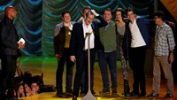 """Writer John Green and the cast of """"The Fault with Our Stars"""" accept the award for Movie of the Year during the 2015 MTV Movie Awards in Los Angeles, California April 12, 2015. REUTERS/Mario Anzuoni"""
