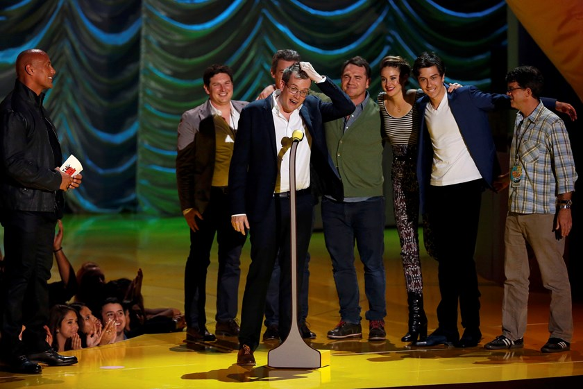"Writer John Green and the cast of ""The Fault with Our Stars"" accept the award for Movie of the Year during the 2015 MTV Movie Awards in Los Angeles, California April 12, 2015. REUTERS/Mario Anzuoni"