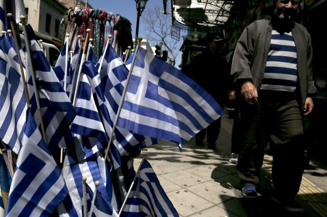 Greek national flags are on display at a shop in central Athens April 17, 2015.