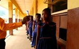 Sierra Leone students back to school after long Ebola closure