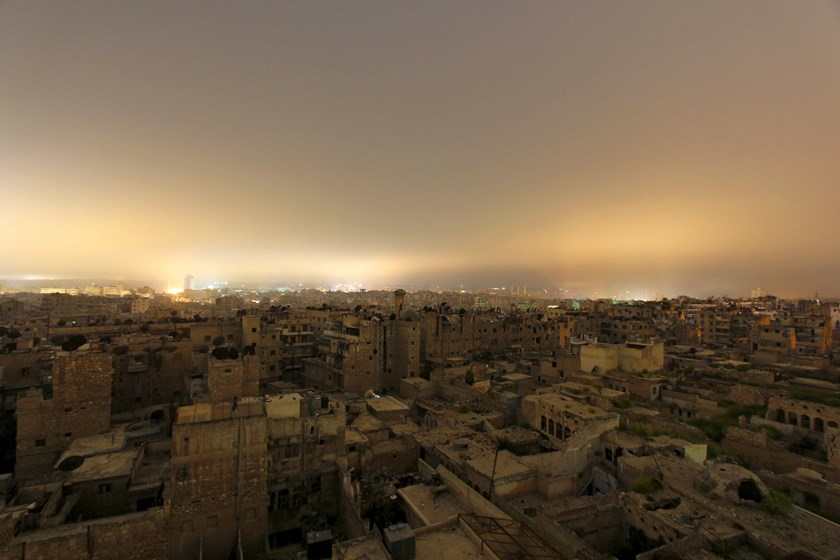 A general view shows damaged buildings in Aleppo city at night April 11, 2015. REUTERS/Rami Zayat