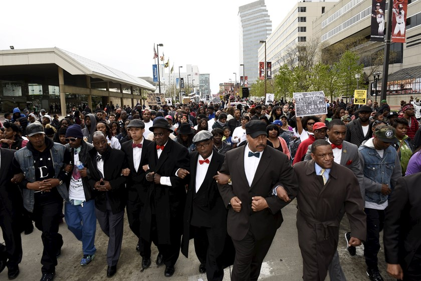 Demonstrators march to City Hall to protest against the death of Freddie Gray in police custody, in Baltimore April 25, 2015. Thousands of people marched peacefully through downtown Baltimore on Saturday to protest the unexplained death of the 25-year-old